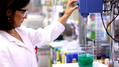 stock-footage-female-engineer-in-laboratory-montage-chemist-working-with-lab-mixer-and-mixing-chemicals-in